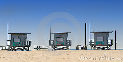 Three lifeguard shacks on Venice Beach, California
