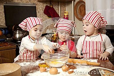 Three little chefs in the kitchen