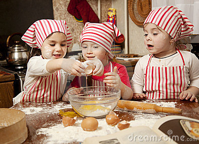 Three little chefs in the kitchen