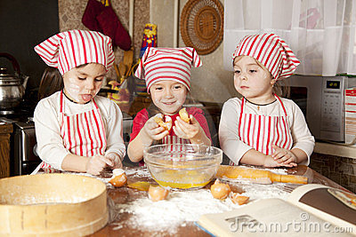 Three little chefsin the kitchen