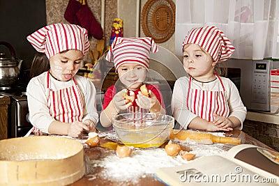 Three little chefsin the kitchen