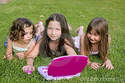 Three little girl playing with toy computer