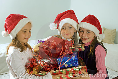 Three little girls with christmas presents