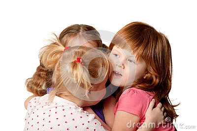 Three little girls sharing secrets