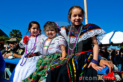 Three little grils in costume on Charro Days Editorial Stock Photo