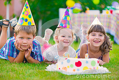 Three little kids celebrating birthday