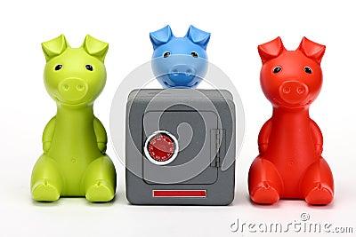 Three little pigs guarding a safe
