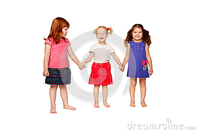 Three lovely smiling little girls holding hands