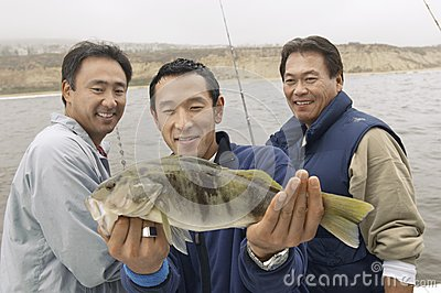 Three Male Friends With A Catch
