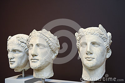 Three male heads sculptures in Classical Greek style