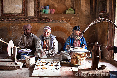 Three masters of cutting marble in Agra, India Editorial Image