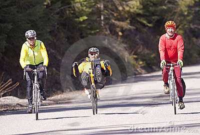 Three men on bikes. Editorial Stock Photo