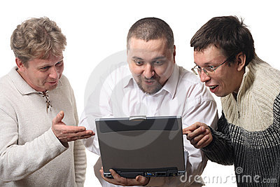 Three men with notebook