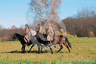 Three men ride horses Editorial Stock Image