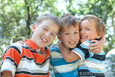 Three merry brothers hugging