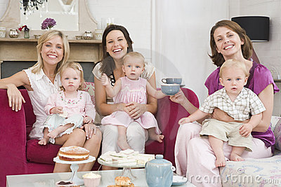 Three mothers in room with babies and coffee