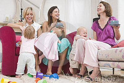 Three mothers in room with coffee and babies