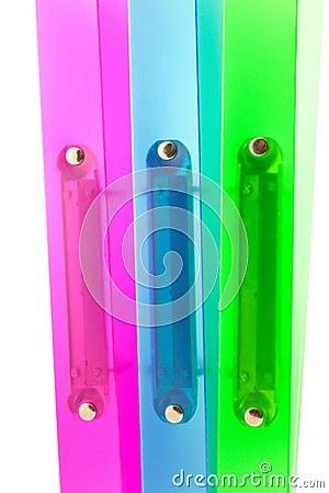 Three multicolored folders