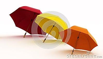 Three multicoloured umbrellas