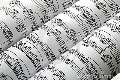 Three music sheets on a row isolated in white