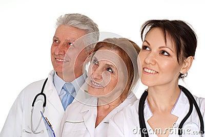 Three nice Caucasian doctor standing