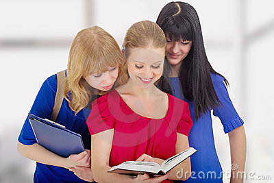 Three nice girls college  discussing the book