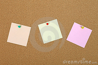 Three note paper on bulletin board.