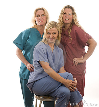 Three nurses in medical scrubs clothes