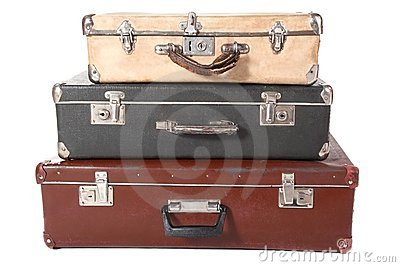 Three old dirty dusty suitcases.