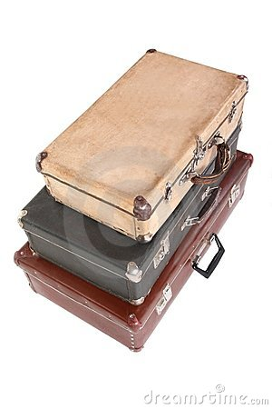 Three old dirty dusty suitcases. Isolated.