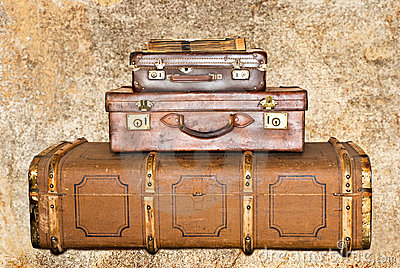 Three old leather suitcases