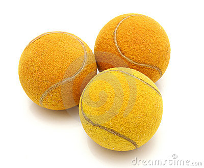 Three old tennis balls