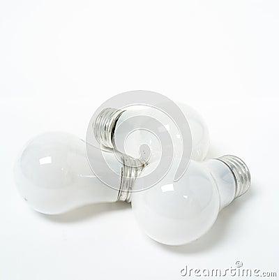 Three old tungsten light bulbs