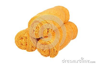 Three orange towels rolls