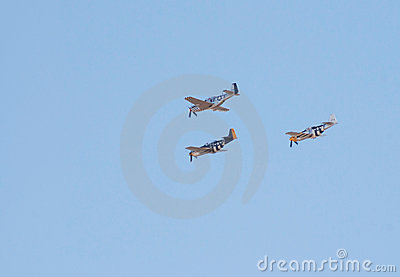 Three P-51 Mustang fighter planes fly in formation Editorial Image