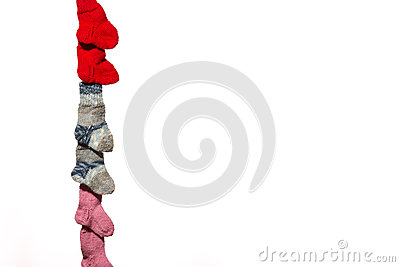 Three pairs of baby socks on white background