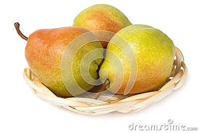 Three pears in wicker basket