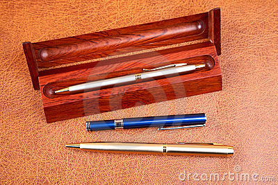 Three pens on a textural