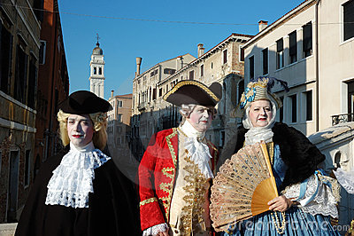 Three people in costumes at Carnival of Venice Editorial Image