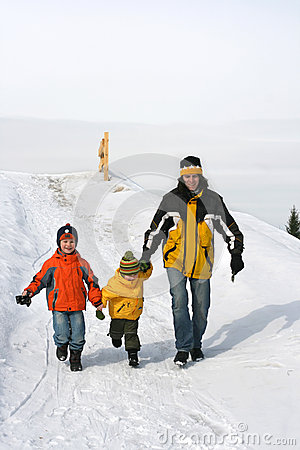 Three people on snow path