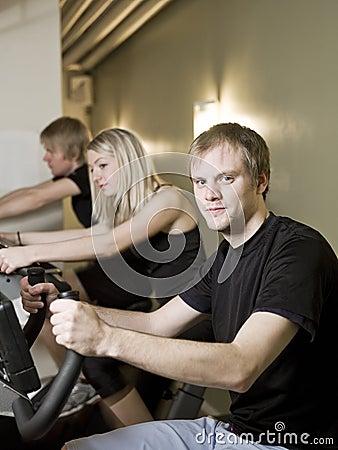 Three people spinning