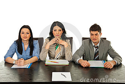 Three people waiting for interview