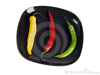 Three peppers on a plate