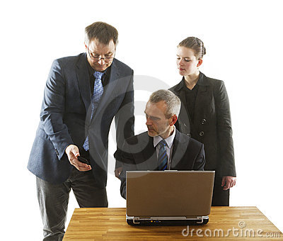 Three persons in an office.