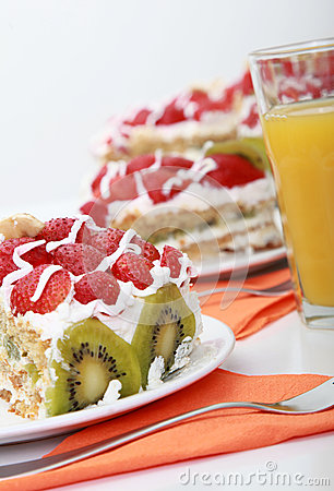Free Three Pieces Of Homemade Cake Is Served With Orange Juice Stock Image - 32855471