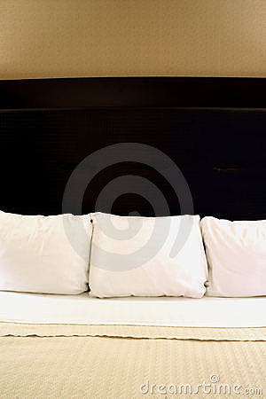 Three Pillows on a Bed
