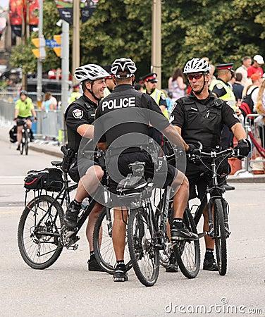 Three Policemen on Bikes Editorial Photo