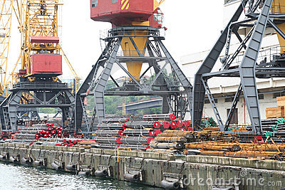 Three port cranes with the cargo