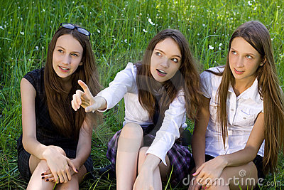 Three pretty student girls in the park