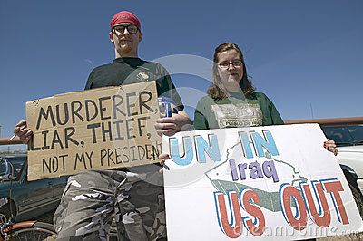 Three protestors in Tucson Editorial Photo